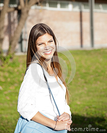Free Student Carrying Shoulder Bag On College Campus Stock Photos - 37119063