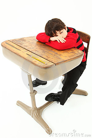 student child sleeping desk school stock images image 17129894