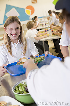 A student collecting lunch in school cafeteria