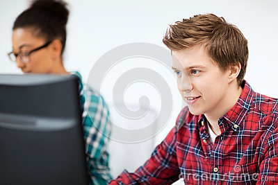 Student with computer studying at school