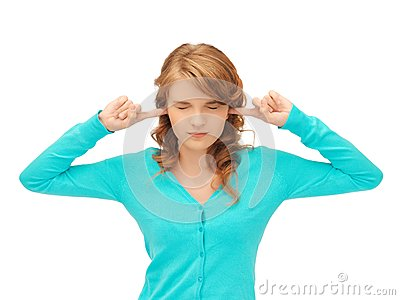 Student with fingers in ears