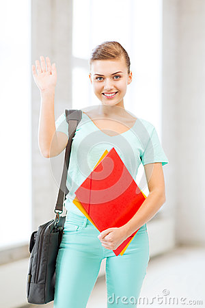Student with folders and school bag in college