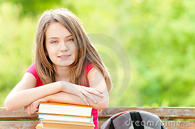 Student girl on bench and smiling