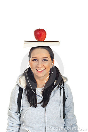 Student girl with book and apple on head