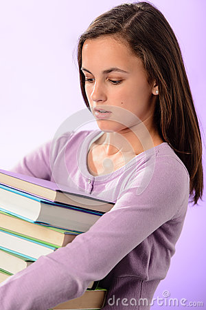 Student girl carry stack of books purple