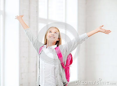Student girl with hands up at school