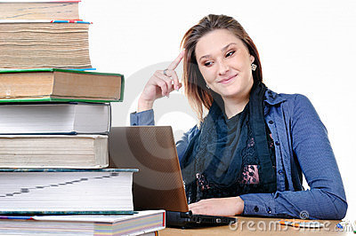 Student girl with a netbook and books