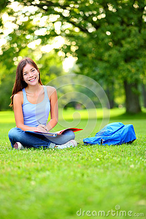 Student girl studying in park going back to school
