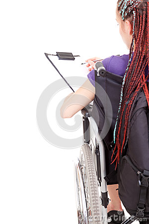 Student girl on wheelchair with clipboard and pen