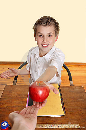 Student gives teacher an apple