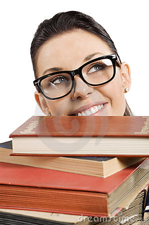 Student with glasses behind books
