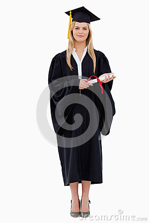 Student in graduate robe holding her diploma