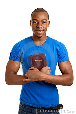 Student holding a bible showing commitment