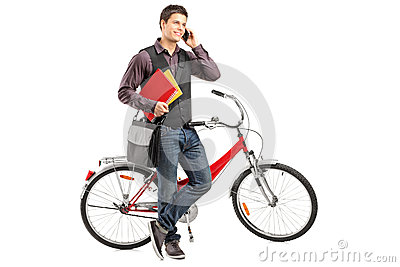Student holding books and talking on a phone