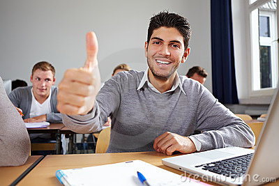 Student holding his thumb up