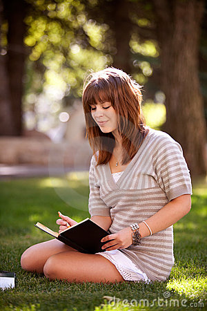 Student with Journal in Park