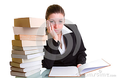 Student learning with pile of books on the desk