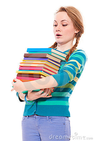 Student looking to pile of books