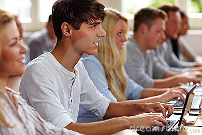 Student with netbook in class