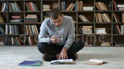 Student with phone taking picture of books page stock footage