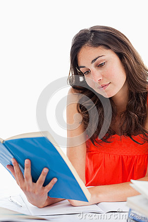 Student reading a blue book