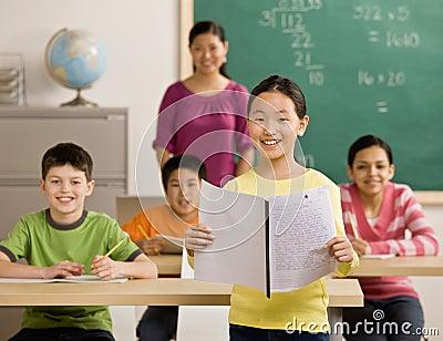 Student reads her report in school classroom