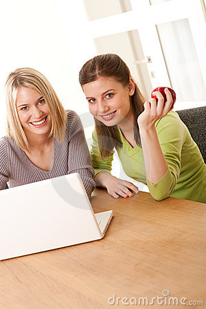 Student series - Two smiling girls watching laptop