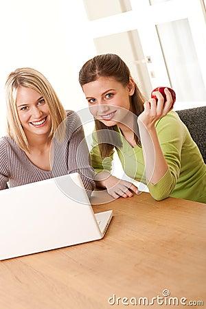 Student series - Two smiling girls watching laptop