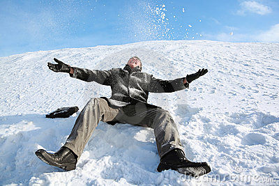 Student sits on snow and merrily throw him