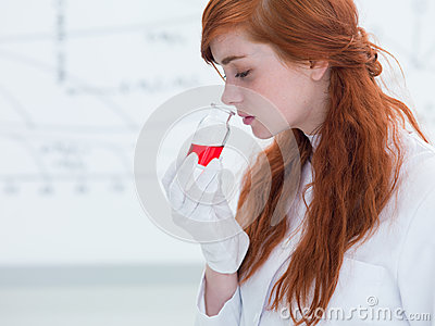 Student smelling lab substances