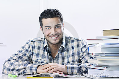 Student smiling with books on white background