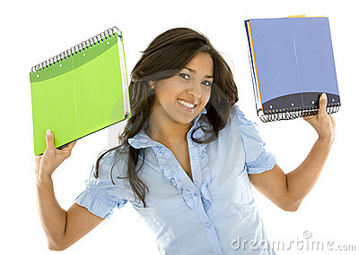 Student smiling with notebooks