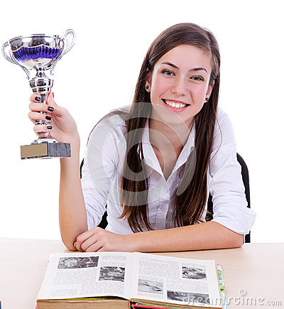 Student smiling with a trophy