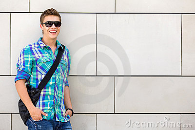 Student standing against wall