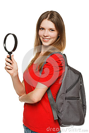 Student standing with magnifying glass