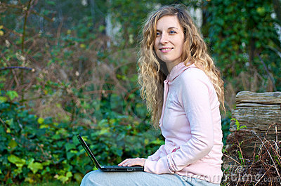 Student studying outdoor with laptop