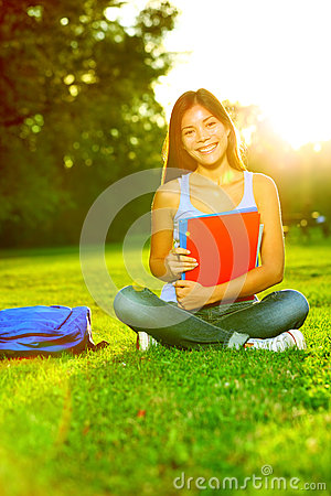 Student studying in park going back to school