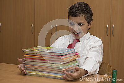 Student is surprised by stack of books