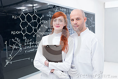 Student and teacher at blackboard