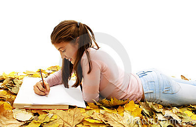 Student teenage girl lying down with leaves around