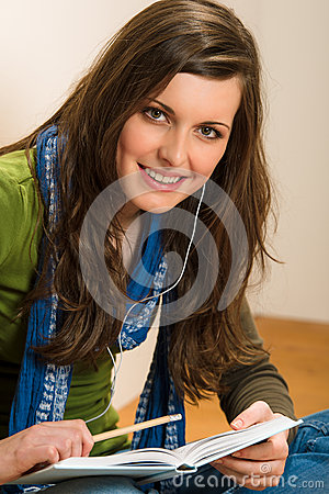 Student teenager woman hold book listen music