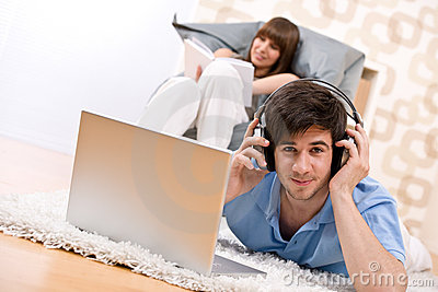 Student - Two teenager with laptop and headphones