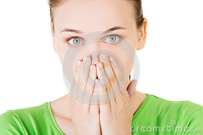 Student woman covering her mouth because of shame Stock Photo
