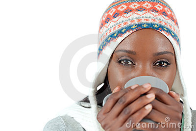 Student woman enjoying a cup of tea in the cold