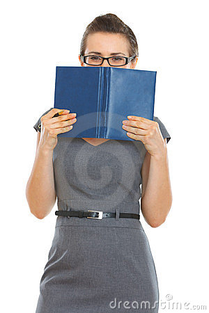 Student woman hiding behind notebook