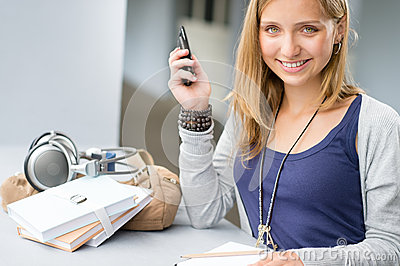 Student woman with notes and cellphone