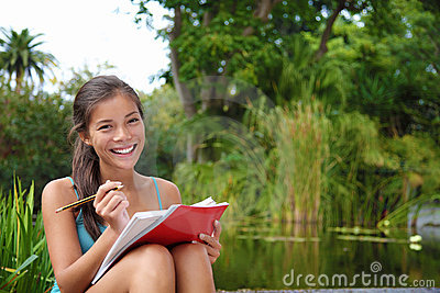 Student woman studying on campus park