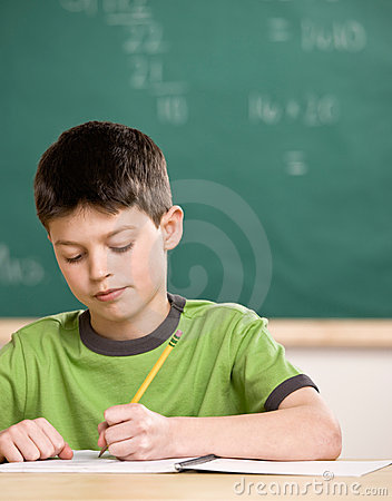 Free Student Writing In Notebook In School Classroom Stock Image - 6598551
