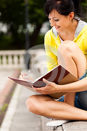 Student young woman with notebook