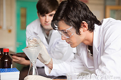 Students in chemistry making an experiment